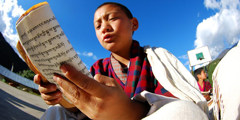 Young Bhutanese boy reading